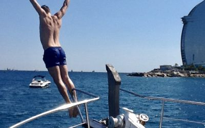 jump in Barceloneta beach with charterinad